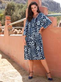 Kleid mit Dekobändern am Ausschnitt