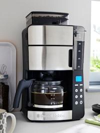 Koffiezetapparaat met geïntegreerd maalwerk en glazen koffiekan