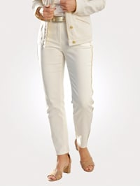 Trousers with shimmering side piping