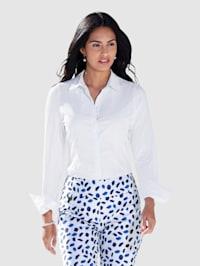 Blus med framstycke i vävt material och bakstycke+ärmar av elastisk jersey