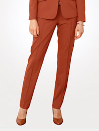 Trousers with pipping