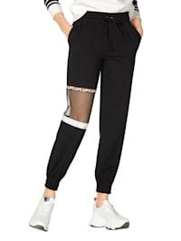 Byxor med meshinfällning på benet