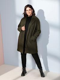 Manteau court en matière duveteuse
