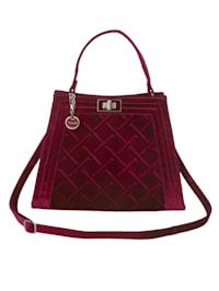 Handväska med dekorativa kviltsömmar