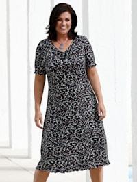 Jerseyklänning med småmönstrat tryck
