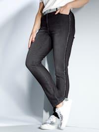 Jeans met flatterende glitterband opzij