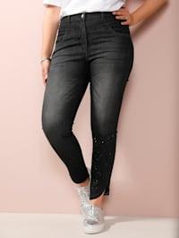 Jeans med pynt på benkanten