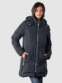 Manteau à glissières aux coutures côtés