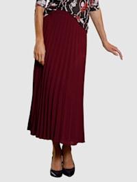 Plisé sukně v rozšířeném střihu