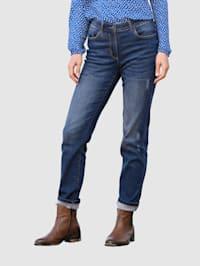 Jeans med slitna effekter