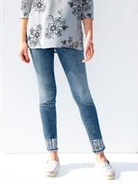 Jeans mit Pailletten am Saum und Fransenabschluss