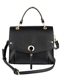 Handväska med dekorativa nitar