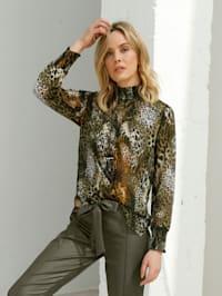 Blus med leopardmönster