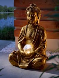 Buddha med solcellsdriven ljuskula
