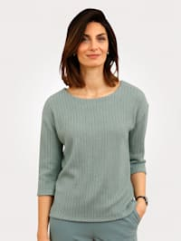 Top in a knit look finish