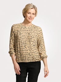 Pull-on blouse with a standout text print
