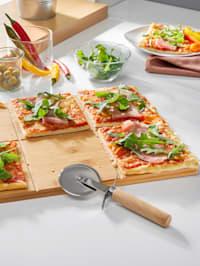 Pizzaskärare och skärbräda för pizza