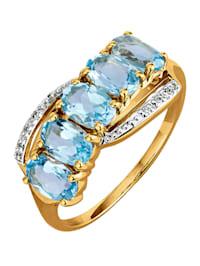 Damesring met blauwtopazen en diamanten
