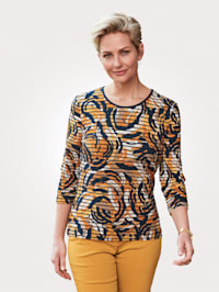 Top with a bold allover print