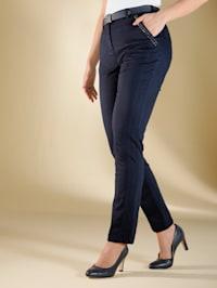 Byxor med stendekoration vid fickorna