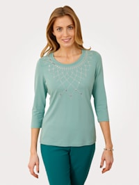 Top with shimmering embellishments