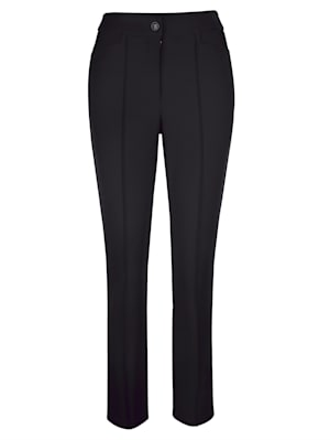 Trousers with leg-lengthening creases