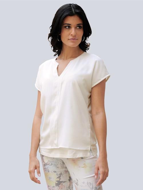 Shirt van een trendy materialenmix