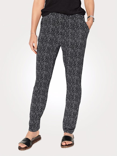 Jersey trousers with a summery spot print