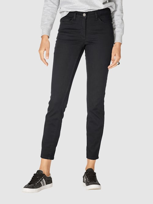 Jeans mit Reißverschluss und Schleife hinten am Beinende