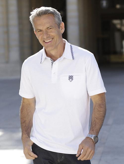 Poloshirt mit aufwändigem Verschluss an der Brusttasche