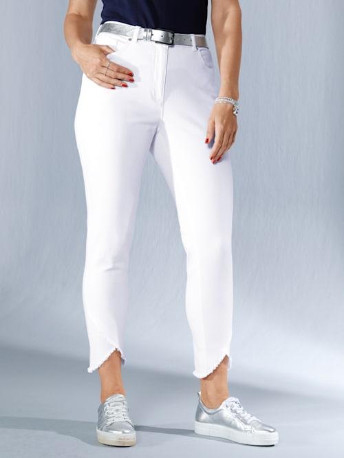 Jeans med asymmetriska benslut