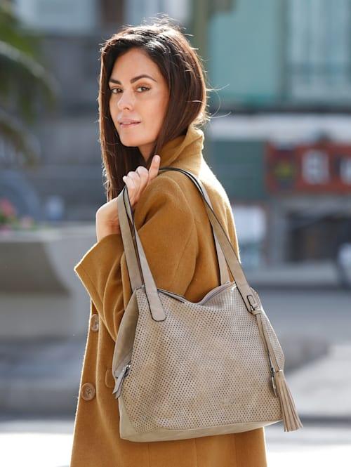 Handbag with cutout detailing