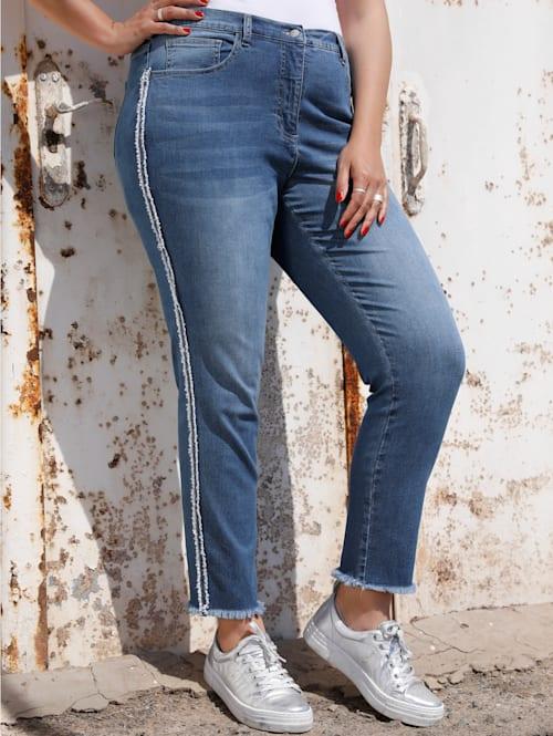 Jeans met decoratieve piping