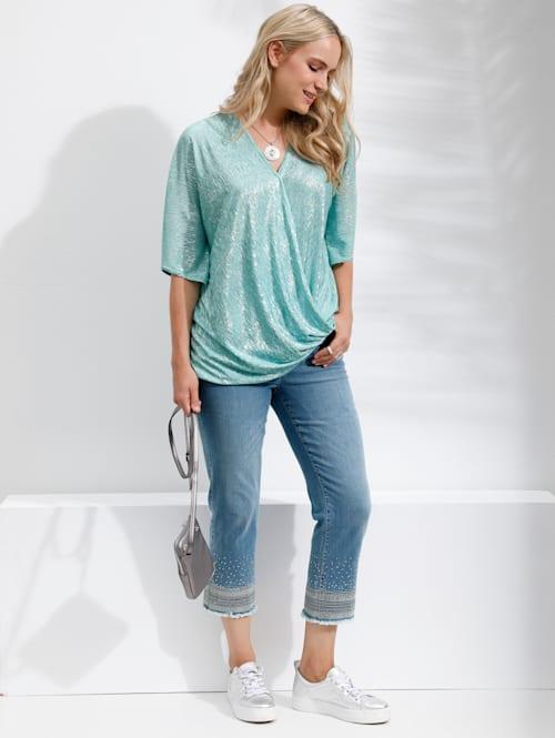 Jeans met borduursels, pailletten en franjes aan de zoom