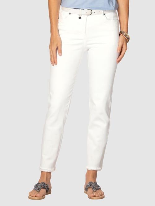 Jeans med trendiga fransar