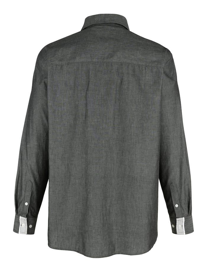 Chemise à poignets réglables