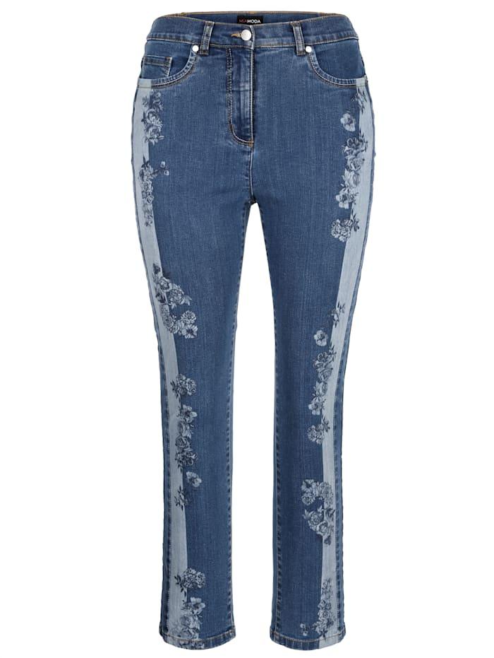 Jeans mit floralem Druckmuster seitlich an den Beinen