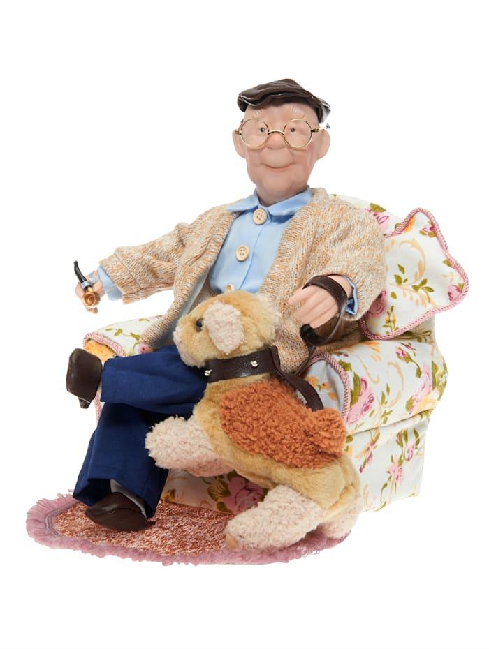 Pop Grootvader in stoel