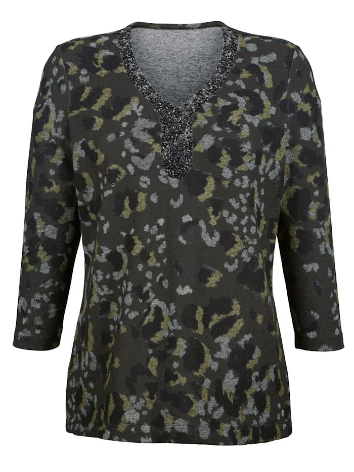 Top with a classic camouflage print