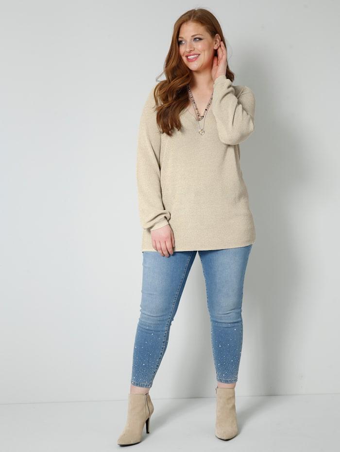 Jeans met split en strikjesapplicatie