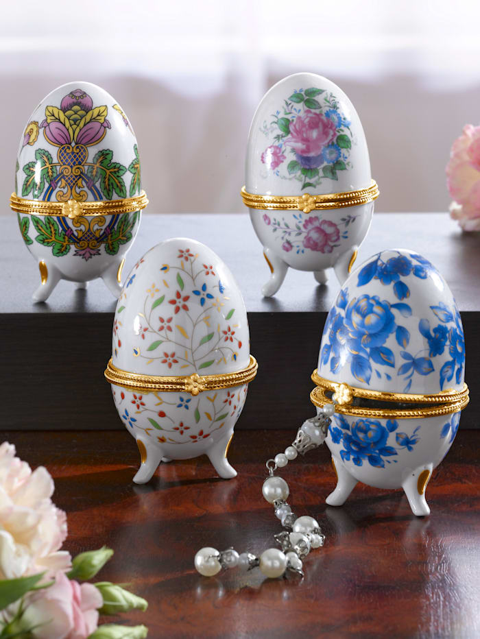 Lot de 4 oeufs en porcelaine