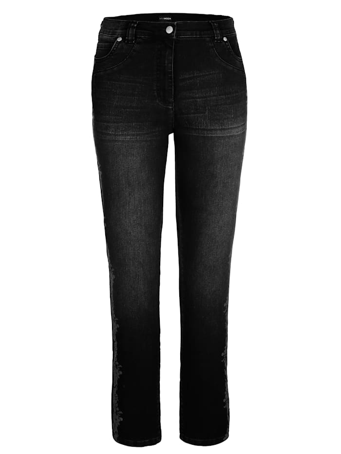 Jeans met folieprint
