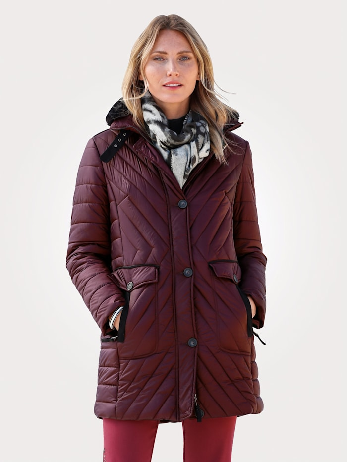Quilted jacket with a detachable faux fur trim