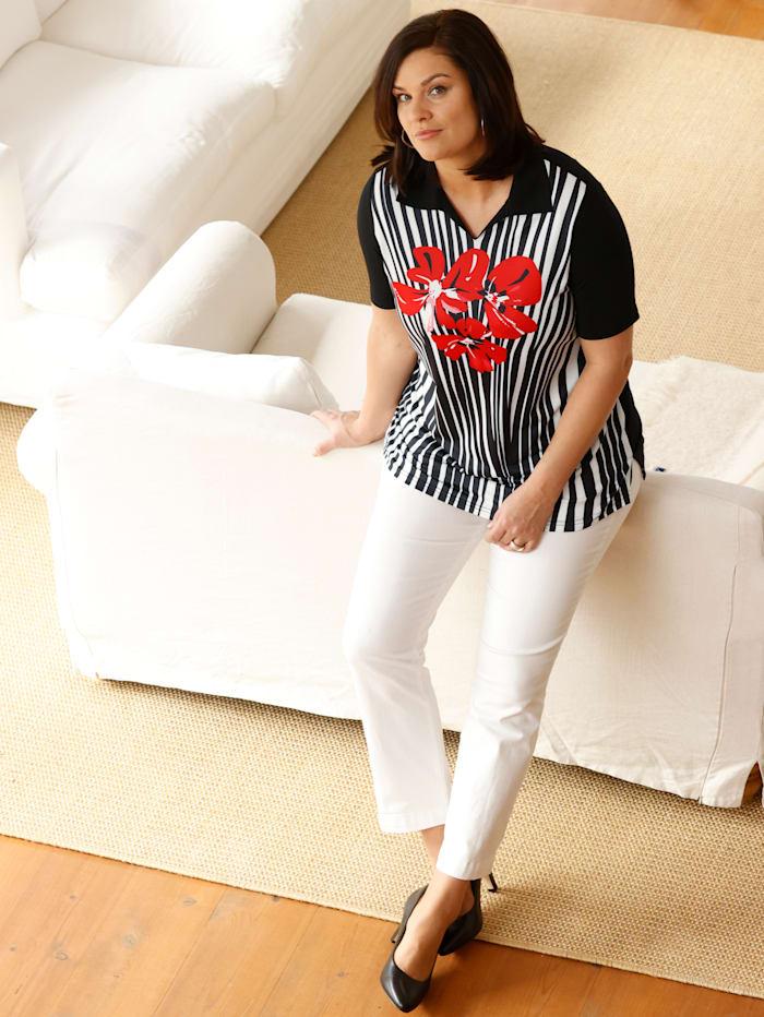 Poloshirt mit platziertem, floralem Druckdesign vorne
