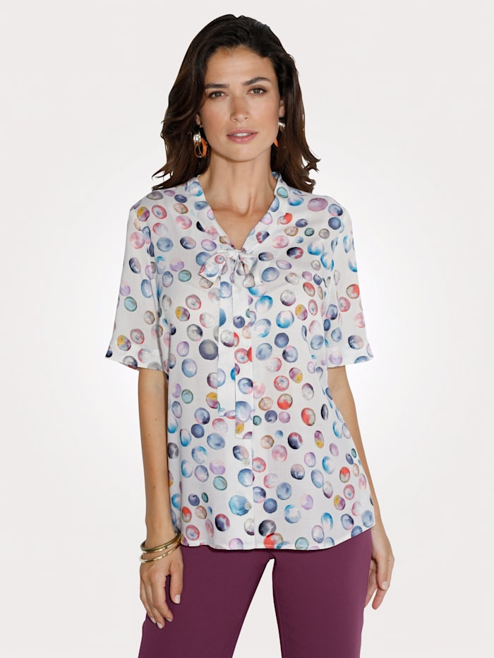 Blouse with a feminine tie neck