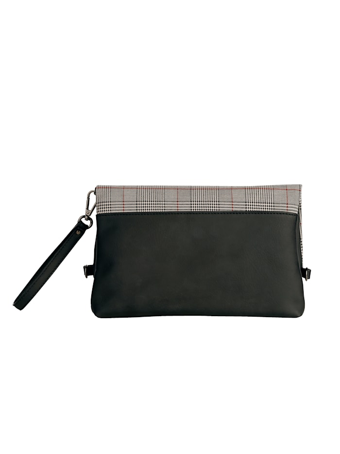 Handväska som kan bäras på olika sätt