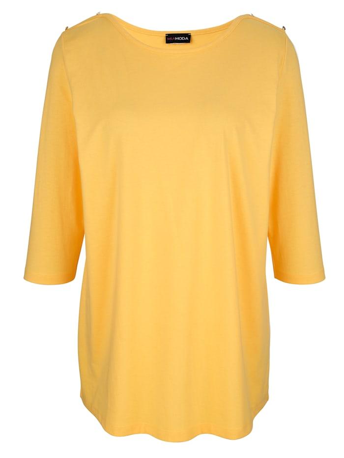 Koristenapillinen paita