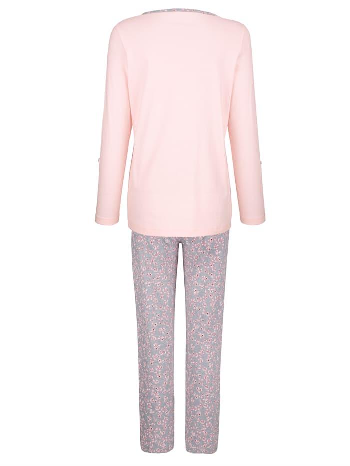 Pyjamas med ärmar som kan vikas upp och fästas med slejf och knapp