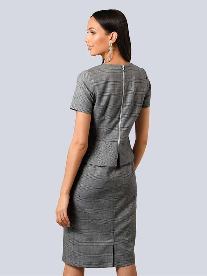Kleid mit femininem Schößchen in der Taille