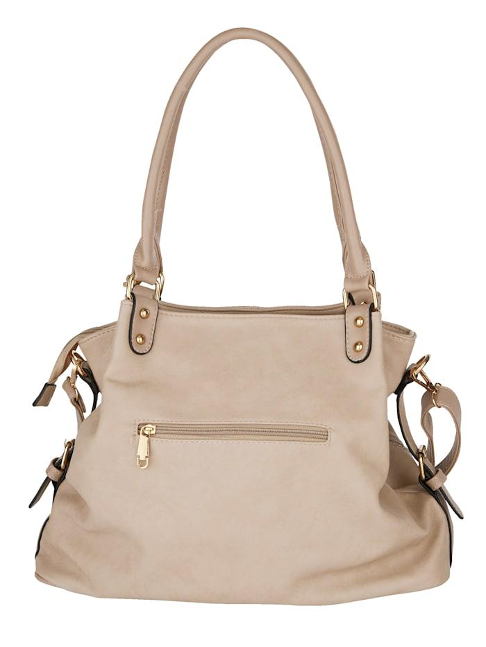 Handbag with a removable pendant